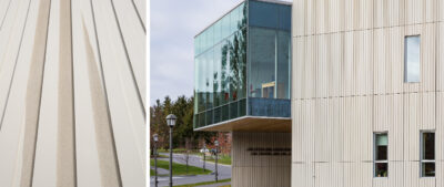 Kennedy Center for Theatre and Studio Arts (Clinton, NY) features 23,500 ft² (2,183m²) of custom dual texture ribbed TAKTKL Architectural UHPC rainscreen cladding.